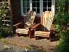 Classic Iroko Adirondack chairs in a cottage garden on the south coast